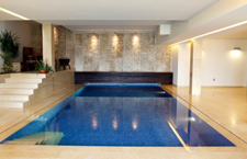 Luxury swimming pool in home with disappearing retractable floor